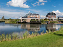 Waterfront family homes in green residential Almere, Netherlands Royalty Free Stock Image