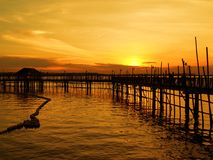 Waterfront Fishing Village. Sunset view from a stilt fishing village Royalty Free Stock Image