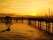Waterfront Fishing Village. Sunrise view from a stilt fishing village Royalty Free Stock Images