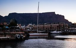 Boat in harbour with Table Mountain royalty free stock photography