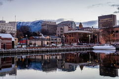 Waterfront in Hobart, Tasmania, Australia. Waterfront in wintertime in Hobart, Tasmania, Australia with Mt. Wellington covered in snow Stock Photography