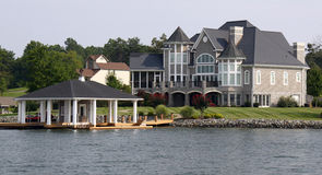 Waterfront Home with Boathouse Royalty Free Stock Photos