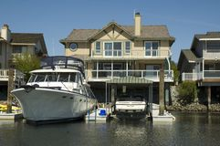 Waterfront home  & huge boat Royalty Free Stock Images