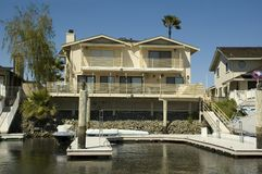 Waterfront Home With Dock Royalty Free Stock Images