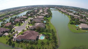 Waterfront homes aerial view stock footage