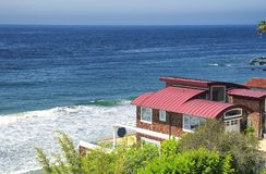 Waterfront homes along the pacific coast highway. A waterfront home in Malibu along the PCH or pacifc coast highway on a sunny day in California Royalty Free Stock Photography