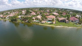 Waterfront homes seen from above stock video footage