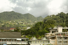 Waterfront Hotels and mountainous landscape at the background in Dominica Royalty Free Stock Photography