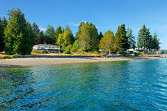 Free Waterfront House In Northwest With Water And Fall Beach. Royalty Free Stock Photo - 72695885