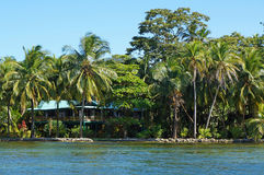 Waterfront house with tropical garden Stock Photos