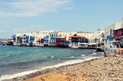 Waterfront houses on famous Mykonos beach, greece Royalty Free Stock Photos