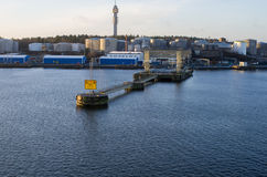 Waterfront with industrial warehouses Stock Photos