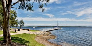 Waterfront Landscape. Murrays Beach. Murrays Beach wharf in the green Murrays Beach waterfront parkland, Lake Macquarie, New South Wales, Australia Royalty Free Stock Photos