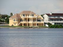Waterfront Living. This large, luxury house is typical for waterfront living in today's world Royalty Free Stock Images