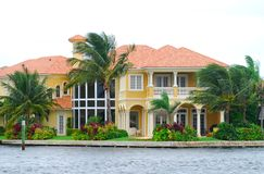 Waterfront mansion Royalty Free Stock Photos