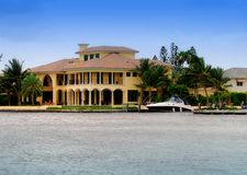 Waterfront mansion Royalty Free Stock Image