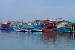 Waterfront marina full of commercial fishing boats Royalty Free Stock Images