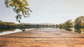 Waterfront with an old wooden landing stage stock photography