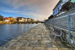 On the waterfront. Waterfront with the oldest stone bridge in Central Europe Stock Photography