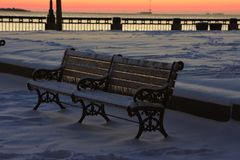 Waterfront Park, Charleston, SC. Sunrise at Waterfront Park in Charleston, after a freak snowstorm dumped over six inches on the low country.  These park benche Royalty Free Stock Image