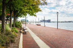 Waterfront Path under a Cloudy Sky with Patches of Blue royalty free stock photo