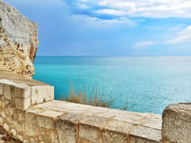 Waterfront and peaceful blue sea of Peniscola, Spain Stock Images