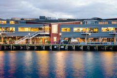 Waterfront Pier at Twilight. Waterfront building on Pier at Twilight with lights reflecting on the water Royalty Free Stock Photos