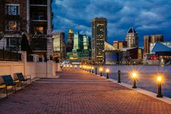 The Waterfront Promenade and Baltimore skyline seen at the Inner Harbor, in Baltimore, Maryland.  stock photos