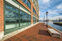 The Waterfront Promenade and building, in Fells Point, Baltimore, Maryland.  royalty free stock images