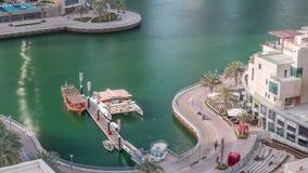 Waterfront promenade in Dubai Marina aerial timelapse. Dubai, United Arab Emirates. Waterfront promenade in Dubai Marina aerial timelapse. Boats and yachts stock footage