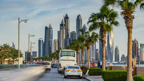 Waterfront promenade on the Palm Jumeirah with palms at road timelapse. Dubai, United Arab Emirates stock video