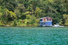 Waterfront property with tropical home overwater Royalty Free Stock Images