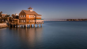 Pier Cafe at Seaport Village, San Diego, California during the day. Pier Cafe waterfront restaurant with smooth ocean and view of Coronado Bridge. A landmark stock images