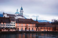 Waterfront of Saint Ursus Cathedral in Solothurn Switzerland. Solothurn, Switzerland - January 3, 2014: Waterfrontof Saint Ursus Cathedral in Solothurn stock images