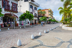 Waterfront Shops - Puerto Vallarta, Mexico. Tourists walking past stores along the Malecón, a 12-block, mile-long esplanade in Puerto Vallarta, Jalisco stock photo