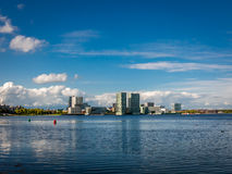 Waterfront skyline Almere-City from Weerwater, Netherlands. Waterfront skyline modern architecture in Almere-City from Weerwater in the province of Flevoland Royalty Free Stock Photography