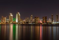 Waterfront skyline at night Stock Photo