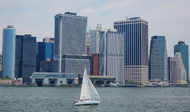 Waterfront skyscrapers in manhattan, new york. South ferry with skyscrapers and sail in manhattan, new york city Stock Images