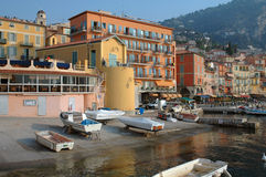 Waterfront At Sunrise In Villefranche, France. Villefranche, France waterfront & boats at sunrise Royalty Free Stock Image
