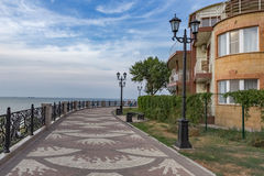 The waterfront in the town of Eisk on the Azov se. A walking path on the shore of the Azov sea with a view of the horizon Royalty Free Stock Images