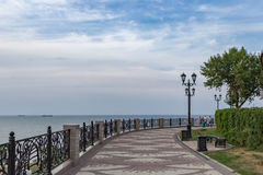The waterfront in the town of Eisk on the Azov sea. A walking path on the shore of the Azov sea with a view of the horizon Royalty Free Stock Photography