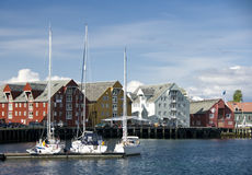 Waterfront at Tromso, Norway. A view of sailboats and the waterfront at Tromso, Norway stock images