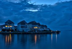 Waterfront vacation homes at at dusk. Waterfront vacations homes located on the calm waters of the Albermarle Sound near Manteo, at the Outer Banks of North Royalty Free Stock Image