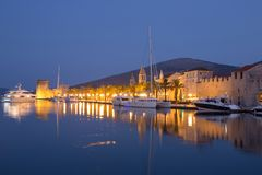 Waterfront view of beautiful Trogir. Croatia - Unesco World Heritage Site. Image take before sunrise, at the blue hour Royalty Free Stock Image