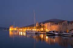 Waterfront view of beautiful Trogir. Croatia - Unesco World Heritage Site. Image take before sunrise, at the blue hour Royalty Free Stock Images