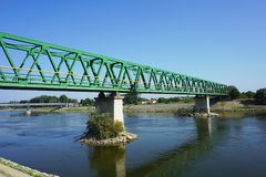 Waterfront view of rail bridge across river Drava in Croatian town Osijek in a summer sunny day stock photography