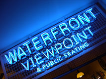Waterfront Viewpoint, Seattle, WA. A very blue neon sign in Seattle offering customers a waterfront viewpoint stock photography