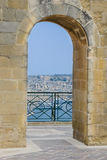 Waterfront views through arched passageway Stock Images