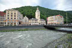Waterfront views of the Mzymta river. In Rosa Khutor (Sochi) and views of the modern hotels stock image