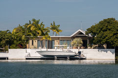 Waterfront villa with boat Royalty Free Stock Photos